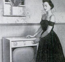 A Setchell Carlson TV from 1954, back when people apparently dressed up to watch TV.  Popular Mechanics, Dec. 1954