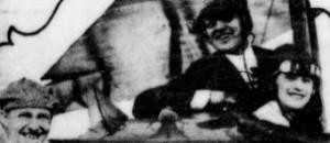 Bride, groom, and pilot at 1922 aeronautical wedding at grandstand.