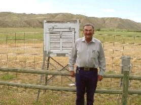 NWS Observer Jim Wood at the location of the 1972 record. NOAA photo.