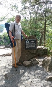 At the marker showing the western terminus of the trail. My station is contained in the blue bag over my left shoulder. The golf ball retriever served as walking stick and antenna support.