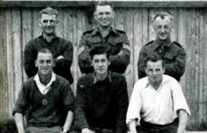 Hodgkinson (front row, center) along with fellow prisoners, 4 New Zealander and 1 English, 1944. Manitoba Calling, Apr. 1944.