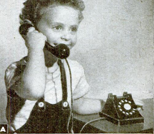 Youngster listening to 1947 toy phone, presumably tuned to strong local station.