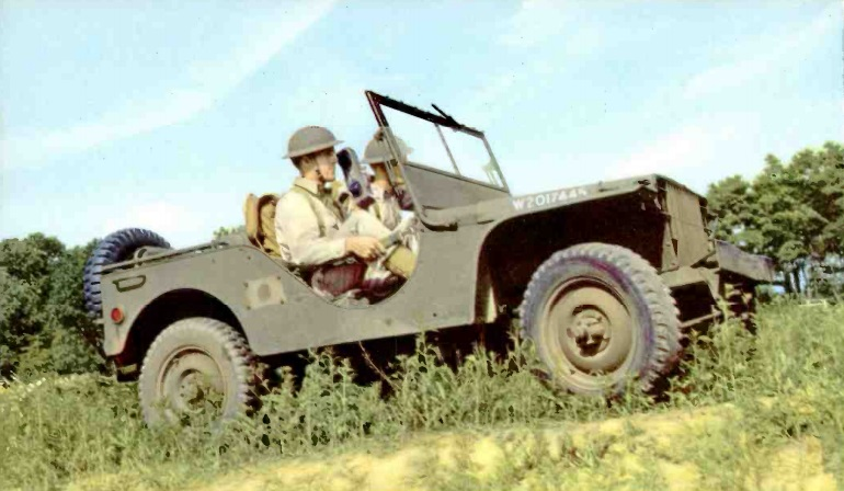 Operation of handheld radio from Jeep, probably around 50 MHz.